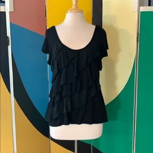 Diagonally ruffled black knit top